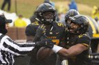 Missouri's Akial Byers, left, celebrates with teammate Terez Hall, right, after Byers recovered a fumble in the end zone during the first half of an NCAA college football game against Arkansas Friday, Nov. 23, 2018, in Columbia, Mo. (AP Photo/L.G. Patterson)