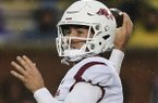Arkansas quarterback Connor Noland throws a pass during a game against Missouri on Friday, Nov. 23, 2018, in Columbia, Mo.