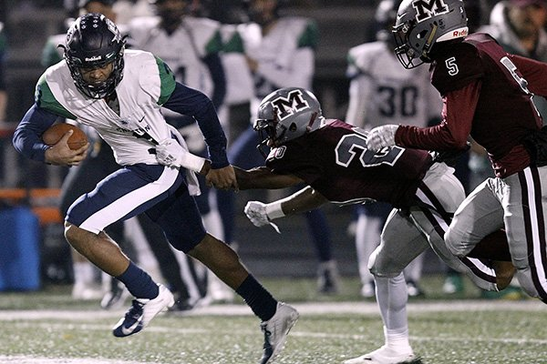 Little Rock Christian quarterback Justice Hill (3) shakes off Morrilton cornerback Darrius Allison (20) during the second quarter of LRCA's 61-42 win in the Class 5A semifinal playoff on Friday, Nov. 23, 2018, at Devil Dog Stadium in Morrilton.