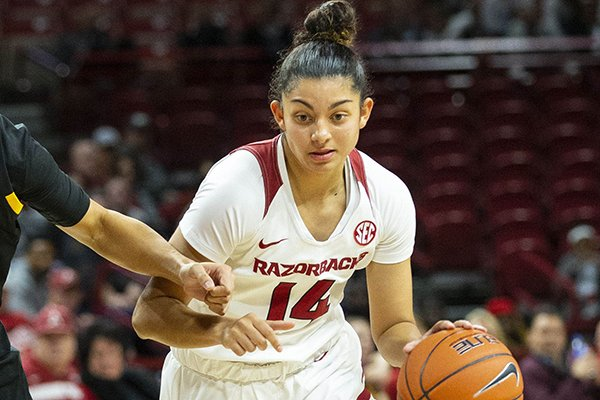 Arkansas guard Jailyn Mason dribbles past an Arizona State defender during a game Sunday, Nov. 18, 2018, in Fayetteville.