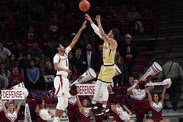 Georgia Tech guard Jose Alvarado shoots over the top of Arkansas guard Isaiah Joe during a game Wednesday, Dec. 19, 2018, in Fayetteville.