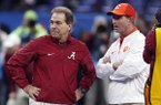 In this Jan. 1, 2018, file photo, Alabama head coach Nick Saban, left, and Clemson head coach Dabo Swinney talk before the Sugar Bowl semifinal playoff game for the NCAA college football national championship in New Orleans. Swinney and the Tigers play in their third national championship game in four seasons next Monday, Jan. 7, 2019, against top-ranked Alabama. (AP Photo/Gerald Herbert, File)
