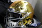 A Notre Dame helmet sits on the sideline during the NCAA Cotton Bowl semi-final playoff football game against Clemson on Saturday, Dec. 29, 2018, in Arlington, Texas. (AP Photo/Roger Steinman)