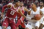 Texas A&M's TJ Starks (2) faces Arkansas' Mason Jones (13) near the basket in the first half of an NCAA college basketball game Saturday, Jan. 5, 2019, in College Station, Texas. (Laura McKenzie/College Station Eagle via AP)
