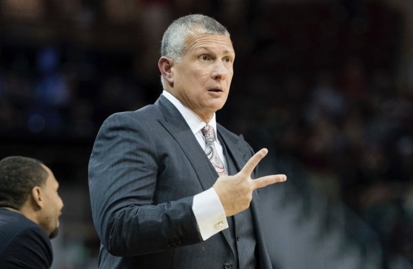 South Carolina head coach Frank Martin communicates with an official during the first half of an NCAA college basketball game Wednesday, Dec. 19, 2018, in Columbia, S.C. Virginia defeated South Carolina 69-52. (AP Photo/Sean Rayford)