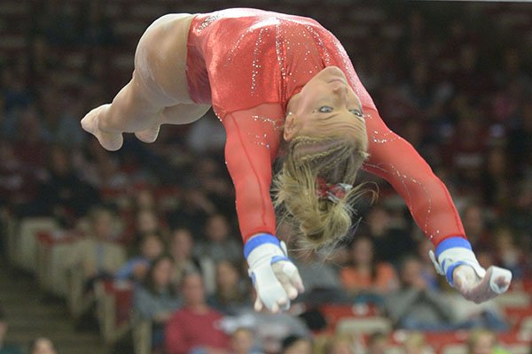 Arkansas' Sarah Shaffer competes in the bars Saturday, Jan. 5, 2019, during the Razorbacks' meet with No. 2 Oklahoma in Barnhill Arena in Fayetteville.