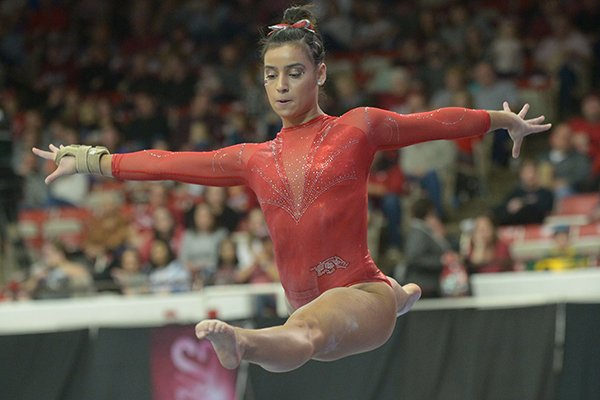 Arkansas' Sophia Carter competes in the beam Saturday, Jan. 5, 2019, during the Razorbacks' meet with No. 2 Oklahoma in Barnhill Arena in Fayetteville.