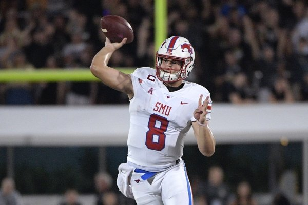 SMU quarterback Ben Hicks (8) throws a pass in front of Central Florida linebacker Gabriel Luyanda (24) and defensive lineman Anthony Montalvo (94) during the second half of an NCAA college football game Saturday, Oct. 6, 2018, in Orlando, Fla. UCF won 48-20. (AP Photo/Phelan M. Ebenhack)