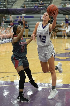 NWA Democrat-Gazette/ANDY SHUPE Fayetteville's Sasha Goforth (13) takes a shot in the lane over Springdale's Ashley Pegue (15) Friday, Jan. 18, 2019, during the first half of play in Bulldog Arena in Fayetteville. Visit nwadg.com/photos to see more photographs from the games.
