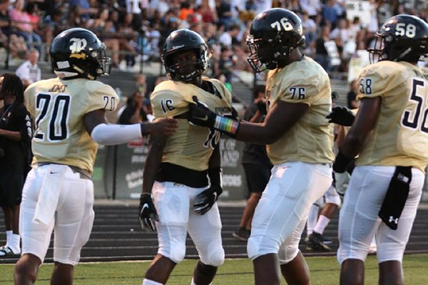 Robinson's Mekel Kentle (16) is congratulated by offensive lineman E'Marion Harris (76) after a touchdown in the second quarter of Robinson's 35-14 win over Rogers on Friday, Aug. 31, 2018, at Charlie George Stadium in Little Rock.