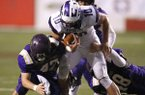 Junction City linebacker Tanner Barnett (47) and defensive end Kyle Kidwell (48) tackle Hazen quarterback Blayne Toll (10) during the first quarter of Junction City's 36-22 win in the Class 2A state championship game on Friday, Dec. 7, 2018, at War Memorial Stadium in Little Rock.
