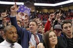 Texas Tech coach Chris Beard celebrates on the court with fans after the team's NCAA college basketball game against Oklahoma, Tuesday, Jan. 8, 2019, in Lubbock, Texas. (AP Photo/Brad Tollefson)