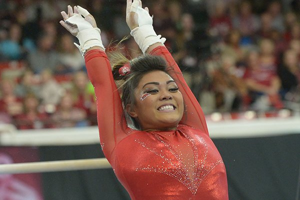 Arkansas' Jessica Yamzon competes in the bars Saturday, Jan. 5, 2019, during the Razorbacks' meet with No. 2 Oklahoma in Barnhill Arena in Fayetteville.
