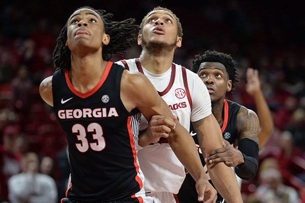 Arkansas forward Daniel Gafford (10) looks to rebound against Georgia forward Nicolas Claxton (33) on Tuesday, Jan. 29, 2019, in Fayetteville.