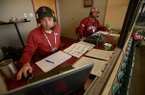 Razorback Sports Network announcers Phil Elson (left) and Bubba Carpenter are shown during a game between Arkansas and Bucknell on Friday, Feb. 16, 2018, in Fayetteville.