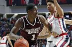 Mississippi State forward Reggie Perry (1) dribbles past Mississippi forward KJ Buffen (14) during the second half of an NCAA college basketball game in Oxford, Miss., Saturday, Feb. 2, 2019. Mississippi State won 81-75. (AP Photo/Rogelio V. Solis)