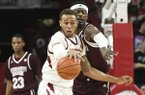 Mississippi State defender Aric Holman (35) puts the pressure on Arkansas forward Daniel Gafford (10) during the second half of an NCAA college basketball game, Saturday, Feb. 16, 2019 in Fayetteville. (AP Photo/Michael Woods)