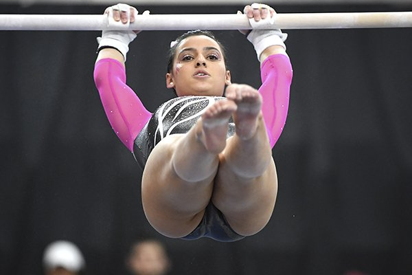Arkansas gymnast Sophia Carter competes on the bars against Alabama during an NCAA Gymnastics meet, Feb. 8, 2019 in Fayetteville. (AP Photo/Michael Woods)