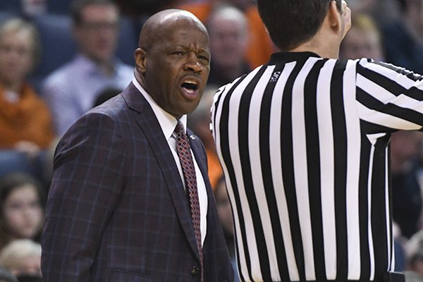 Arkansas head coach Mike Anderson talks to an official during the first half of an NCAA college basketball game against Auburn Wednesday, Feb. 20, 2019, in Auburn, Ala. (AP Photo/Julie Bennett)