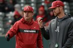 Arkansas coach Dave Van Horn speaks to pitching coach Matt Hobbs against Eastern Illinois Saturday, Feb. 16, 2019, during the seventh inning at Baum-Walker Stadium in Fayetteville.