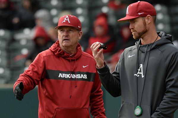 Arkansas coach Dave Van Horn speaks to pitching coach Matt Hobbs against Eastern Illinois Saturday, Feb. 16, 2019, during the seventh inning at Baum-Walker Stadium in Fayetteville.