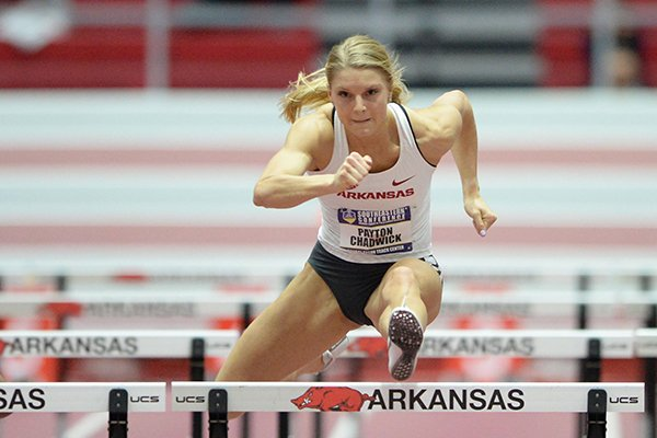 Arkansas' Payton Chadwick clears the final hurdle as she competes Friday, Feb. 22, 2019, in a preliminary of the 60-meter hurdles during the Southeastern Conference Indoor Track and Field Championship at the Randal Tyson Track Center in Fayetteville.