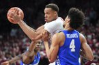 Arkansas' Daniel Gafford looks for room while Kentucky's Nick Richards plays defense Tuesday Feb. 20, 2018 during the first half at Bud Walton Arena in Fayetteville.