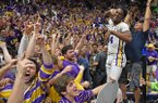 LSU forward Emmitt Williams (24) celebrates with the LSU student section after an overtime victory in an NCAA college basketball game against Tennessee, Saturday, Feb. 23, 2019, in Baton Rouge, La. LSU won in overtime 82-80.(AP Photo/Bill Feig)