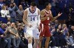 Kentucky's Tyler Herro (14) and Arkansas' Jalen Harris (5) react after a play during the second half of an NCAA college basketball game in Lexington, Ky., Tuesday, Feb. 26, 2019. Kentucky won 70-66. (AP Photo/James Crisp)
