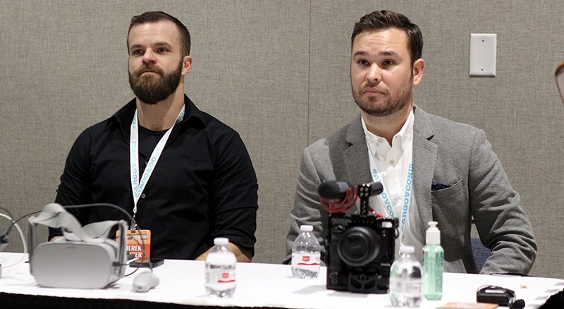 The Sentinel-Record/Grace Brown VIRTUAL REALITY: Derek Huber, left, and Dylan Roberts, both with the Freelance Society, are introduced during the Governor's Conference on Tourism at the Hot Springs Convention Center on Tuesday.
