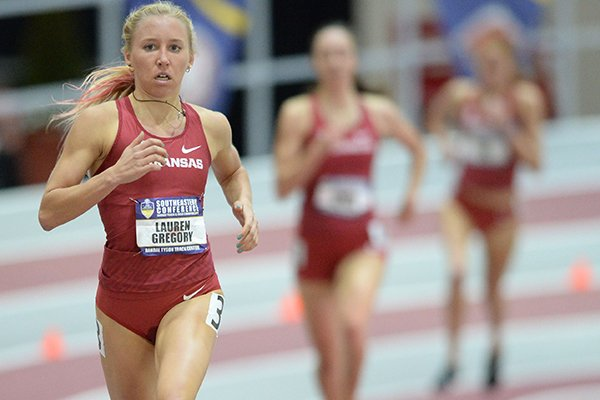 Arkansas' Lauren Gregory nears the finish line in the mile at the Southeastern Conference Indoor Track & Field Championships on Saturday, Feb. 23, 2019, in Fayetteville. The Razorbacks finished 1-2-3 in the event.