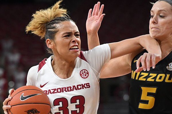 Arkansas' Chelsea Dungee drives to the basket while Missouri's Lauren Aldridge defends during a game Thursday, Feb. 28, 2019, in Fayetteville.