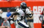 Baltimore Ravens running back Alex Collins (34) plays against the Cleveland Browns during overtime in an NFL football game, Sunday, Oct. 7, 2018, in Cleveland. (AP Photo/Ron Schwane)