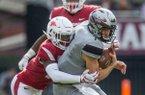 Joe Foucha, Arkansas free safety, tackles Nick Fitzgerald, Mississippi State quarterback, on a run in the third quarter Saturday, Nov. 17, 2018, at Davis Wade Stadium in Starkville, Miss.