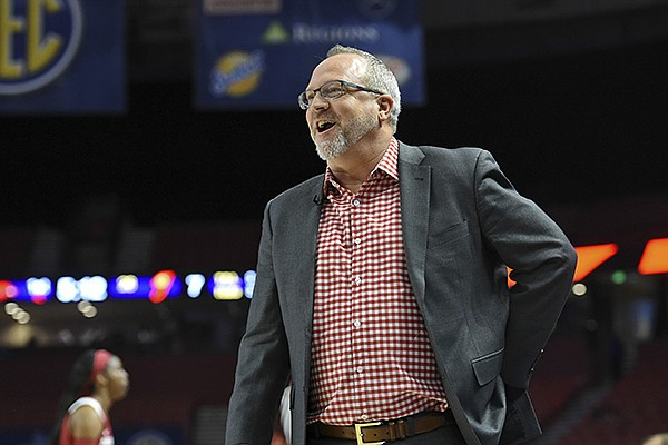 Arkansas head coach Mike Neighbors reacts during the first half of a women's Southeastern Conference NCAA college basketball tournament game against Georgia, Thursday, March 7, 2019, in Greenville, S.C. (AP Photo/Richard Shiro)