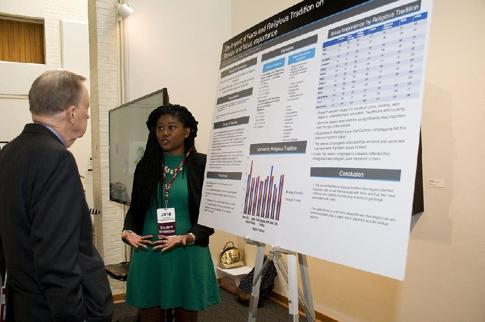 Faith Thomas, a student researcher for the 2016 Little Rock Congregations Study, presents some of her original findings. Led by Dr. Rebecca Glazier of the University of Arkansas at Little Rock's School of Public Affairs, the study aims to learn more about faith-based community involvement.