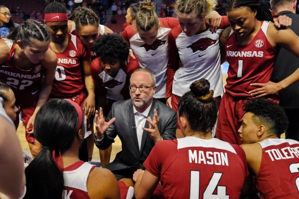 Arkansas head coach Mike Neighbors gives instructions during the second half of an NCAA college basketball game against Texas A&M in the Southeastern Conference women's tournament Saturday, March 9, 2019, in Greenville, S.C. (AP Photo/Richard Shiro)