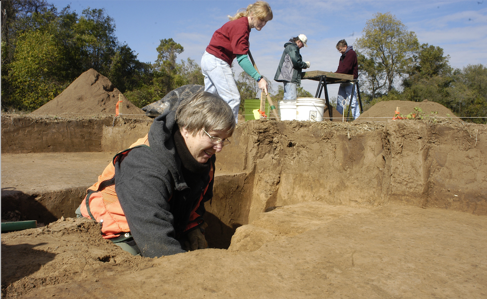 Volunteers in 2003 help excavate for artifacts at an archeological dig thought to be the possible location of the Quapaw village of Osotouy. (Democrat-Gazette file photo)