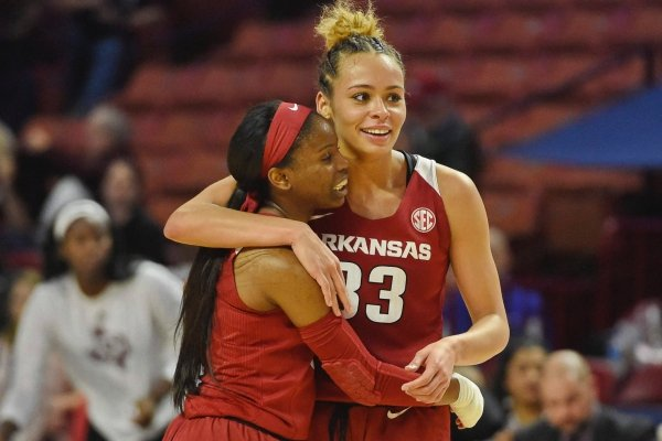 Arkansas' Cheksea Dungee, right, and Malica Monk celebrate after an NCAA college basketball game against Texas A&M in the Southeastern Conference women's tournament Saturday, March 9, 2019, in Greenville, S.C. (AP Photo/Richard Shiro)
