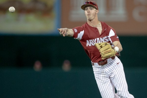 Arkansas infielder Casey Martin throws to first for an out against Texas during an NCAA college baseball game Wednesday, March 20, 2019, in Austin, Texas. (Nick Wagner/Austin American-Statesman via AP)