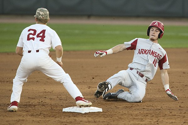 Arkansas designated hitter Matt Goodheart (10) slides safely into second base with a double during an NCAA college baseball game in Tuscaloosa, Ala., Friday, March 22, 2019. (Gary Cosby Jr./The Tuscaloosa News via AP)