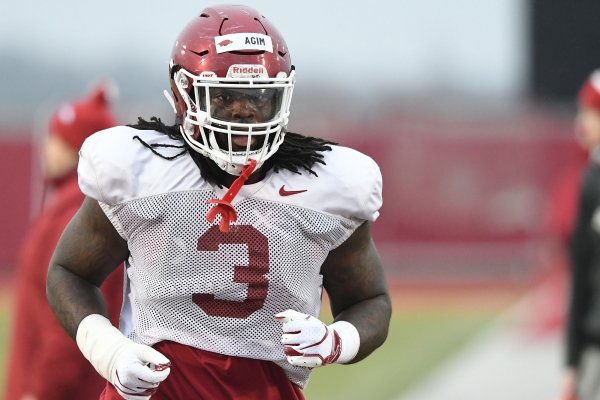 Arkansas defensive lineman McTelvin Agim goes through practice Thursday, March 9, 2019, in Fayetteville.