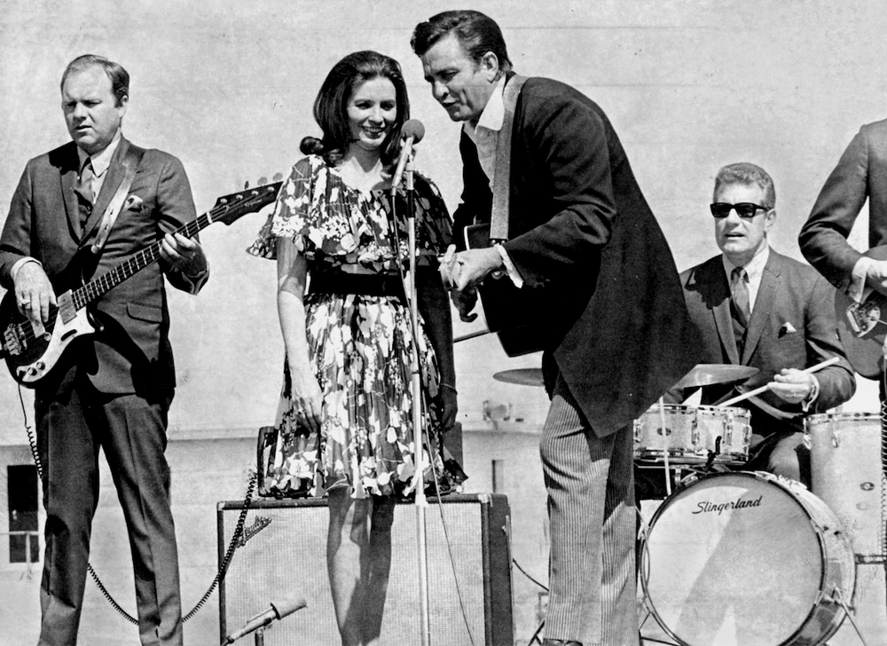 June Carter Cash and Johnny Cash at the microphone during their show at Cummins Prison. (Democrat-Gazette file photo)
