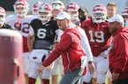 Arkansas coach Chad Morris instructs players during practice Tuesday, March 26, 2019, in Fayetteville.