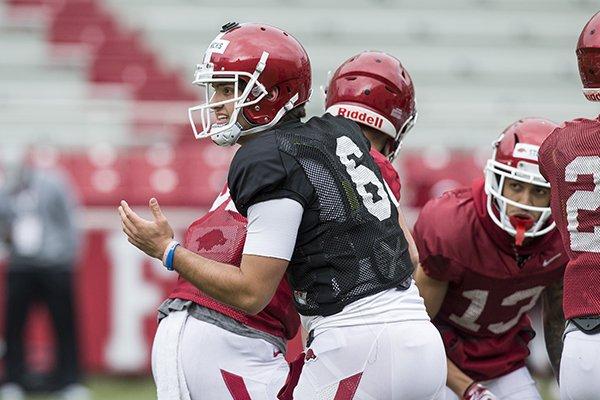 Arkansas quarterback Ben Hicks talks to teammates during practice Saturday, March 30, 2019, in Fayetteville.