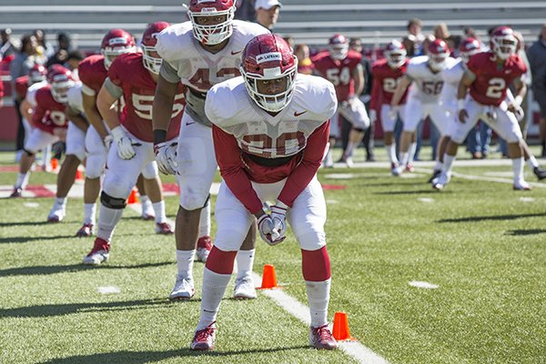 Arkansas linebacker Giovanni LaFrance goes through warmups prior to practice Saturday, March 9, 2019, in Fayetteville.