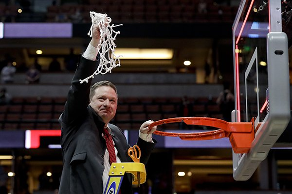 Texas Tech coach Chris Beard holds up the net after the team's win over Gonzaga in the West Regional final in the NCAA men's college basketball tournament Saturday, March 30, 2019, in Anaheim, Calif. Texas Tech won 75-69. (AP Photo/Marcio Jose Sanchez)