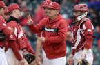 Arkansas coach Dave Van Horn motions toward the bullpen during a game against Ole Miss on Saturday, March 30, 2019, in Fayetteville.