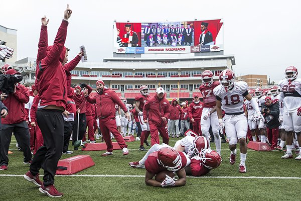 Arkansas players run a drill during practice Saturday, March 30, 2019, in Fayetteville.