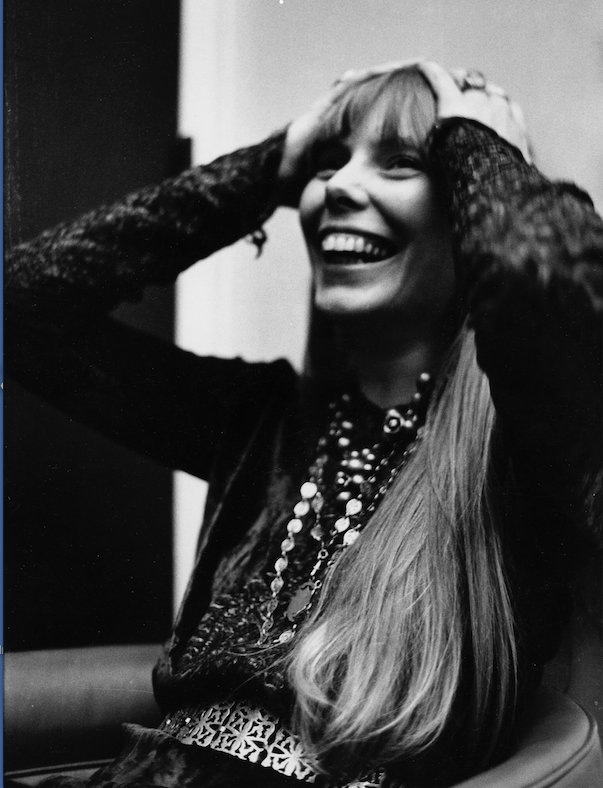 Joni Mitchell shows her excitement after her first, sold-out performance in New York's Carnegie Hall in 1969. (Democrat-Gazette file photo)